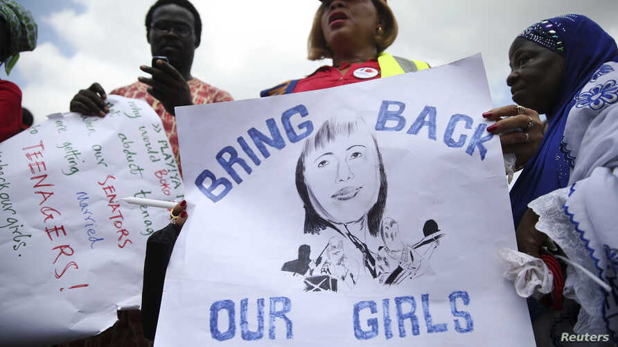 People take part in a protest demanding the release of abducted secondary school girls from the remote village of Chibok, in Lagos, May 5, 2014.