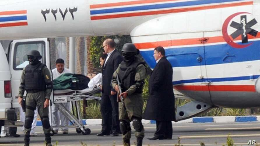 Former Egyptian president Hosni Mubarak is carried from an ambulance to a helicopter for his trial in Cairo, Egypt, Thursday, Jan. 5, 2012.