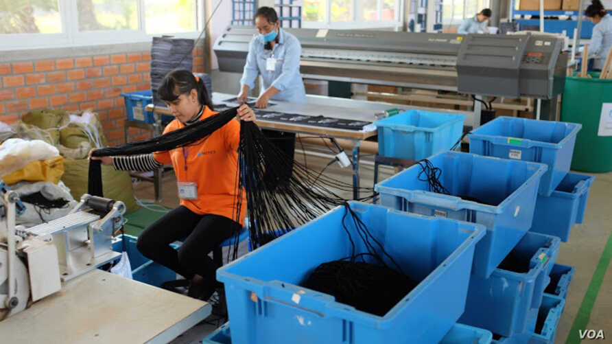 The factory is SA8000 certified -- the highest standard in social compliance, a rarity for a company in Cambodia. (S. Herman/VOA)
