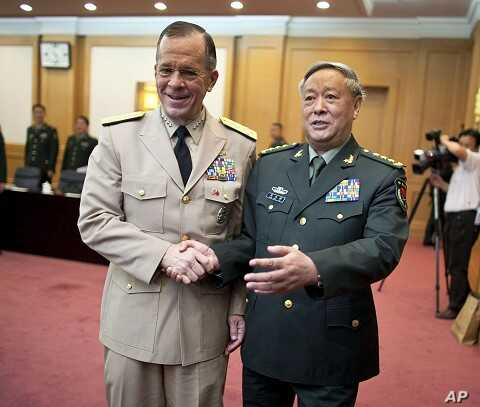 U.S. Admiral Mike Mullen (L), chairman of the Joint Chiefs of Staff, shakes hands with General Chen Bingde, chief of the General Staff of the Chinese People's Liberation Army, before their meeting at the Bayi Building in Beijing July 11, 2011.