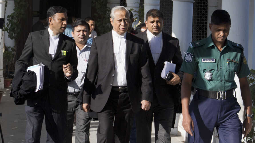 FILE - Attorney General  of Bangladesh, Mahbubey Alam, center, walks out of the Supreme Court after the hearing of a review petition relating to the death sentence of Harkatul Jihad leader, Mufti Abdul Hannan, in Dhaka, Bangladesh, Wednesday, Dec. 7,