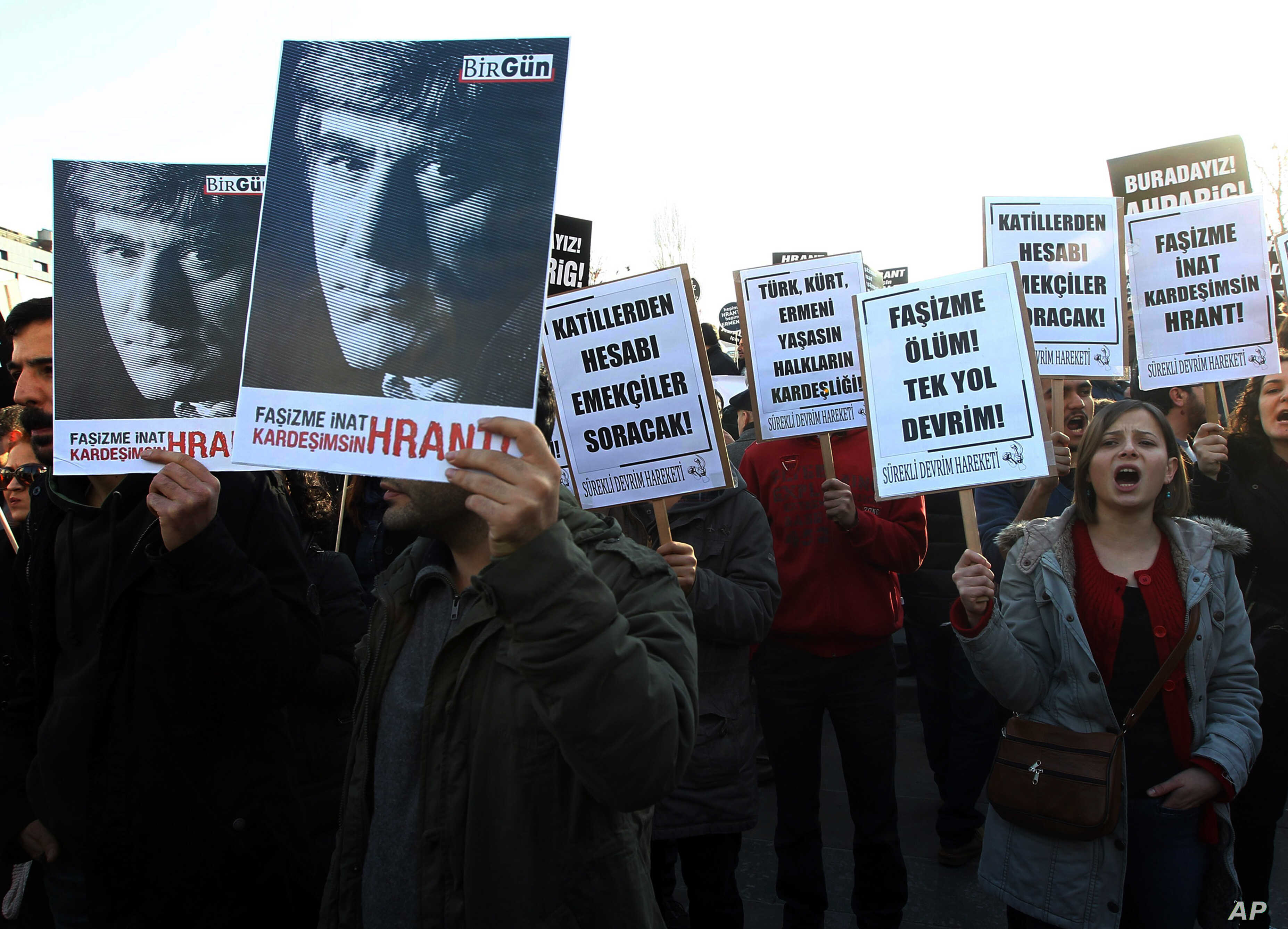 Hundreds of protesters march to mark the seventh anniversary of Turkish-Armenian journalist Hrant Dink's murder in Ankara, Turkey, Jan.19, 2014 as outrage continues to grow over a trial that failed to shed light on alleged official negligence or even