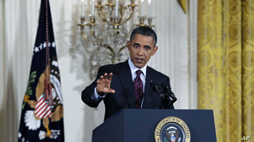 U.S. President Barack Obama answers a question during a news conference at the White House, June 29, 2011