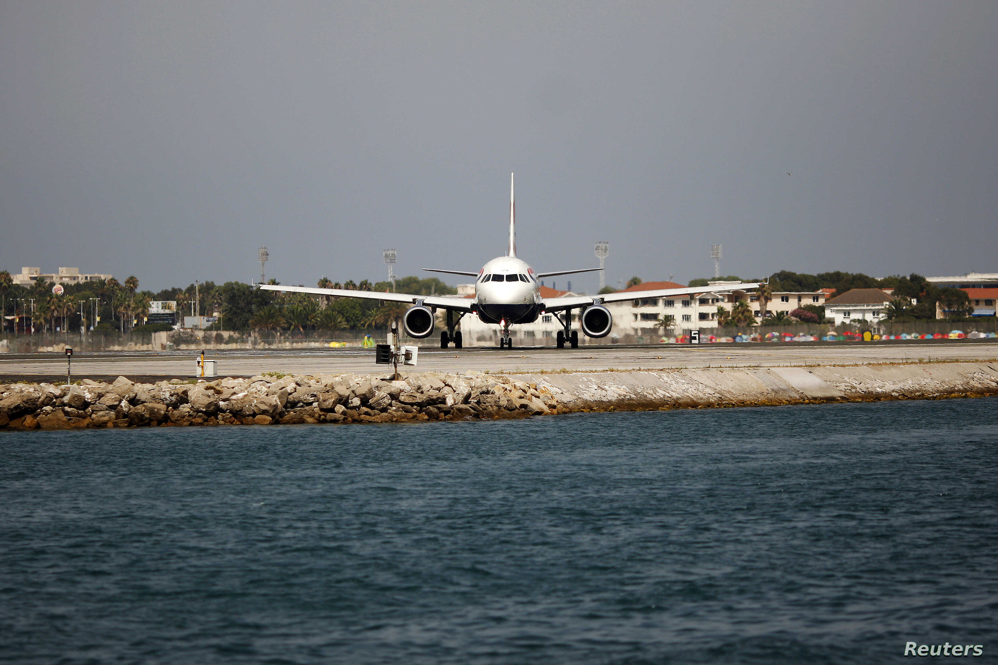 A British Airways plane is seen on the tarmac before taking off at the Gibraltar International airport, in Gibraltar, south of Spain, August 4, 2013.