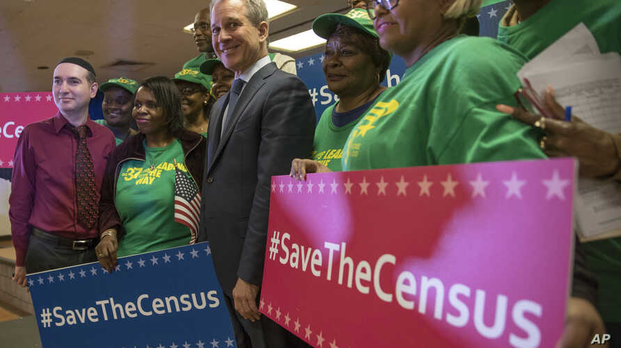 New York Attorney General Attorney General Eric Schneiderman stands with members of District Council 37 after a news conference in New York, April 3, 2018. Schneiderman announced a new lawsuit by 17 states, the District of Columbia and six cities aga