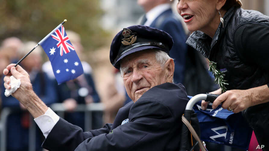 FILE - A veteran is pushed in a wheelchair during the ANZAC Day parade, in Sydney, Friday, April 25, 2014, commemorating the anniversary of the first major military action fought by Australian and New Zealand Army Corps (ANZAC) during the First World