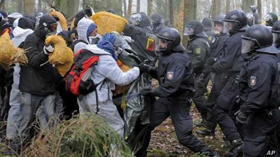 Anti-nuclear activists stand in front of the German riot police during clashes near Leitstade, northern Germany, 07 Nov 2010.