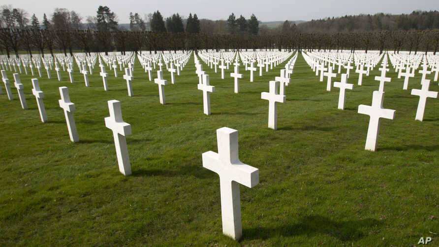 FILE - A view of the rows of crosses of American World War I soldiers at the Meuse-Argonne American cemetery in Romagne-sous-Montfaucon, March 24, 2017. It was America's largest and deadliest battle, with 26,000 U.S. soldiers killed and tens of thous