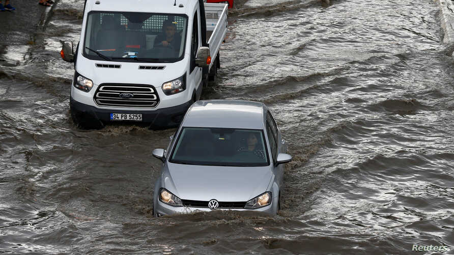 Vehicles drive on a flooded road after a heavy rainfall in Istanbul, Turkey July 18, 2017.
