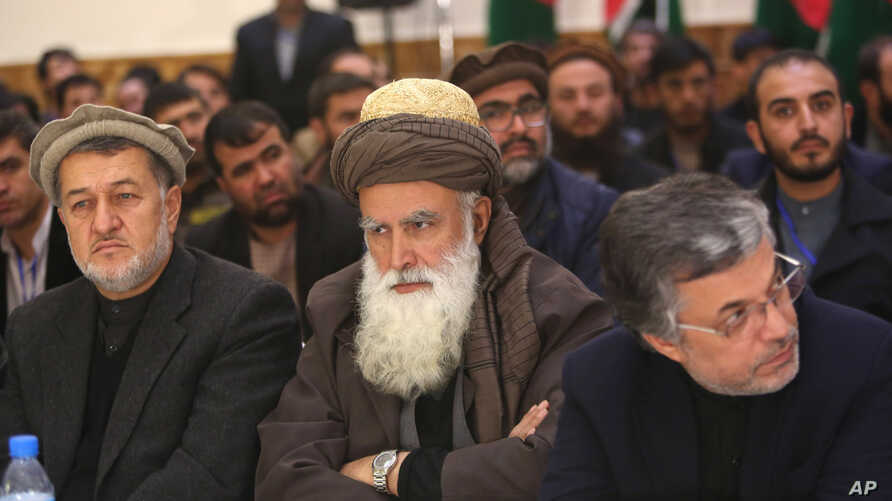 Former Afghan warlord Abdul Rasool Sayyaf, center, attends the inauguration of the Afghanistan Protection and Stability Council in Kabul, Afghanistan, Friday, Dec. 18, 2015.