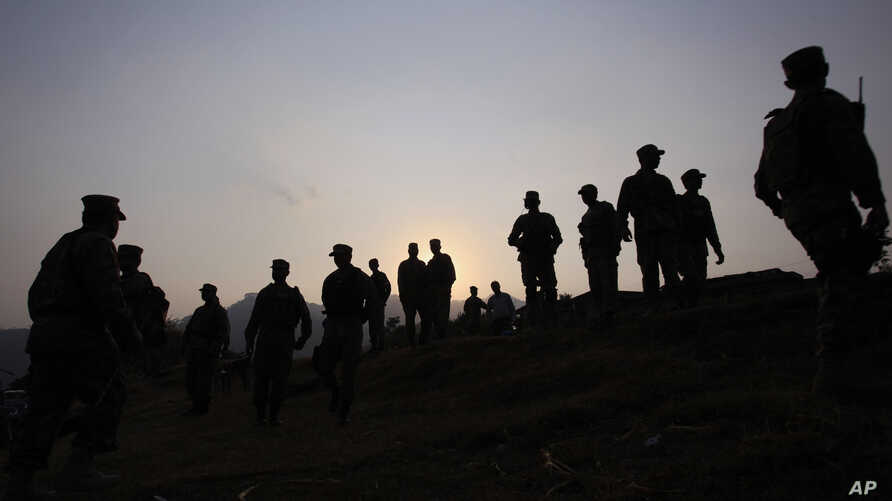 FILE - Pakistan army soldiers gather at a forward area post on the Line of Control (LOC) that divides Kashmir between Pakistan and India, in Tatta Pani, some 200 km, from Islamabad, Pakistan, Oct. 1, 2016. On Monday, Nov. 14, 2016, Pakistan's army cl...
