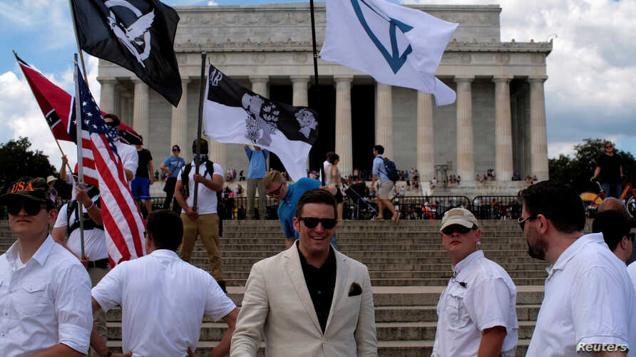"FILE - Richard B. Spencer approaches a self-proclaimed White Nationalists and members of the ""alt-right"" during what they described as a ""Freedom of Speech"" rally at the Lincoln Memorial in Washington, June 25, 2017."