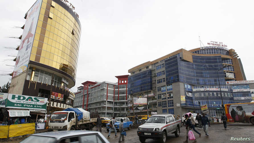 FILE - People walk through the streets of a shopping area in Addis Ababa, May 26, 2014.