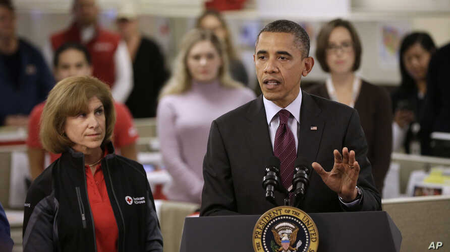 President Barack Obama, accompanied by American Red Cross President and CEO Gail J. McGovern, gestures while speaking during the his visit to the Disaster Operation Center of the Red Cross National Headquarter in Washington D.C. to discuss superstorm