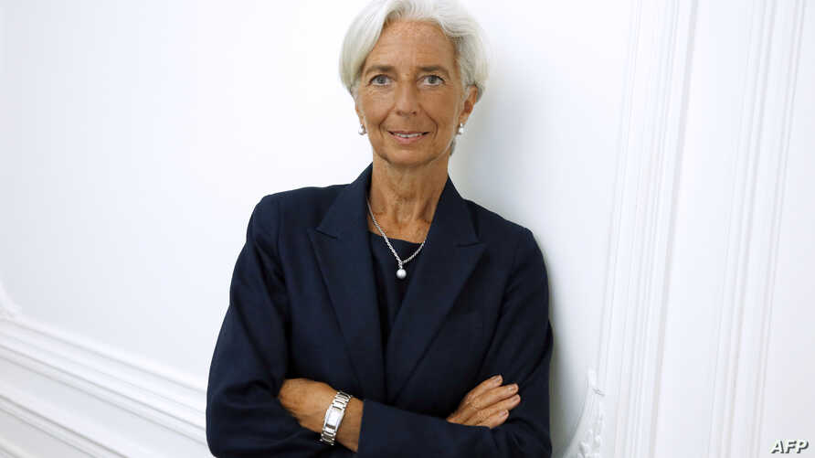 IMF chief Christine Lagarde poses on the sideline of a press conference, Aug. 27, 2014.