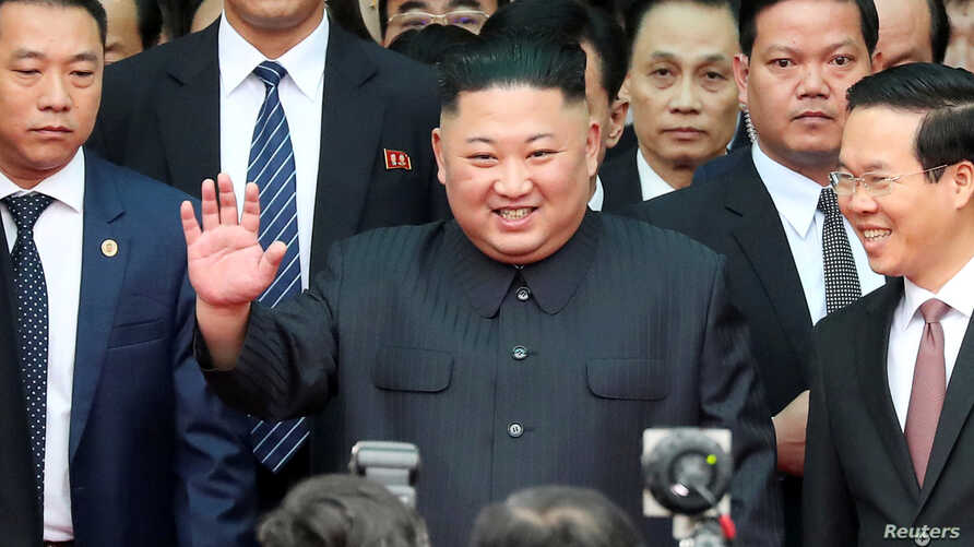 North Korea's leader Kim Jong Un waves as he arrives at the Dong Dang railway station, Vietnam, at the border with China, Feb.  26, 2019.