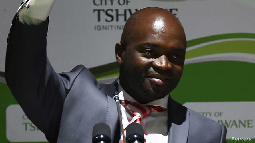 Solly Msimanga of the Democratic Alliance waves to his suppoters after being officially installed as the new mayor of Tshwane, South Africa, Aug. 19, 2016.