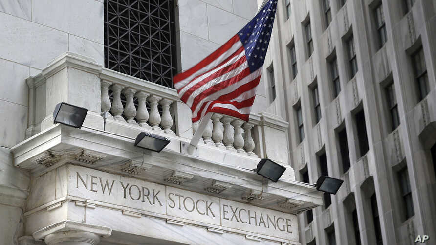 FILE - The New York Stock Exchange is seen Aug. 24, 2015. U.S. stocks are opening slightly higher Nov. 20, 2017, as technology companies and retailers make gains.
