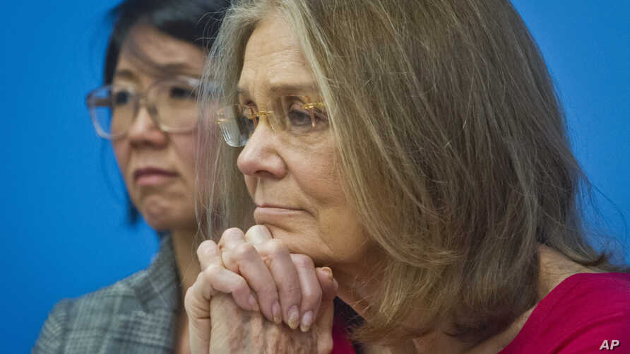 FILE - Organizers of WomenCrossDMZ, including honorary co-chair Gloria Steinem, right, and lead coordinator Christine Ahn, left, listen during a U.N. news conference announcing plans for a women's walk across the demilitarized zone between North and