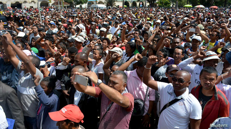 """Madagascar demonstrators from the opposition chant slogans as they protest after the president denounced unrest in which two people were killed as a """"coup"""" intended to divide the country's people in Antananarivo, Madagascar, April 23, 2018."""