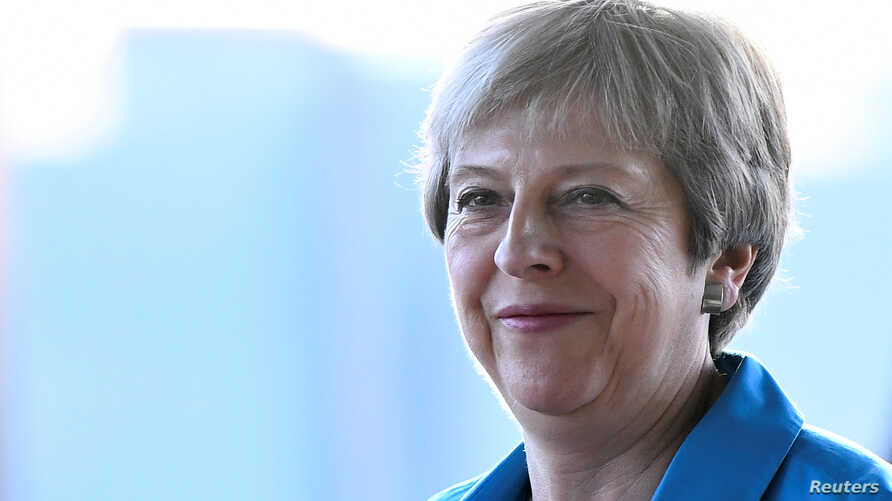 British Prime Minister Theresa May arrives for the Conservative Party Conference in Birmingham, England, Sept. 29, 2018.