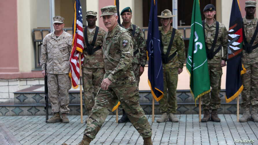 FILE - Commander of NATO Resolute Support forces and United States forces in Afghanistan, U.S. Army General John Nicholson walks during a change of command ceremony in Resolute Support headquarters in Kabul, Afghanistan, March 2, 2016.