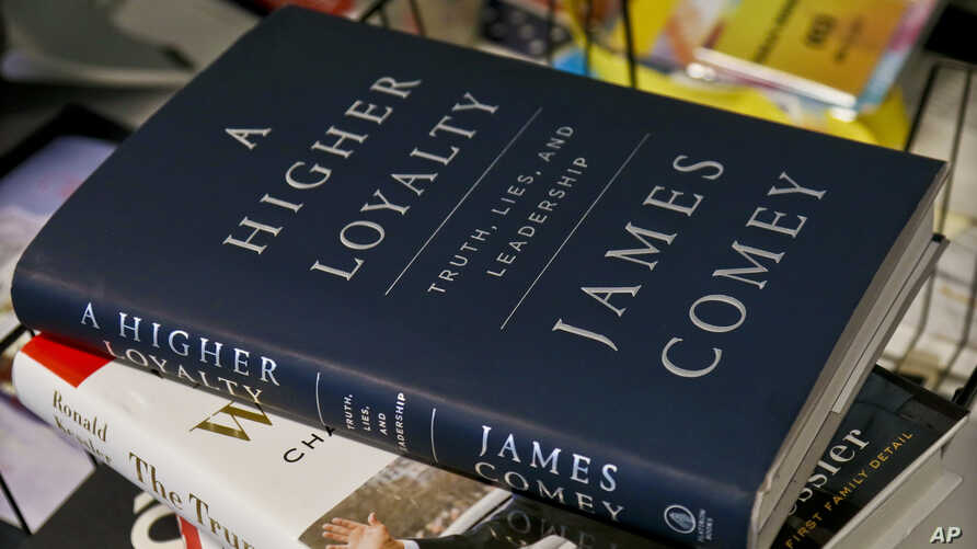 """A copy of former FBI Director James Comey's new book, """"A Higher Loyalty: Truth, Lies and Leadership,"""" is on display, Apr. 13, 2018, in New York."""