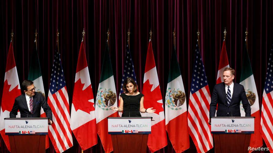 Canada's Foreign Minister Chrystia Freeland, center, addresses the media with Mexico's Economy Minister Ildefonso Guajardo, left, and U.S. Trade Representative Robert Lighthizer at the close of the third round of NAFTA talks involving the United Stat...