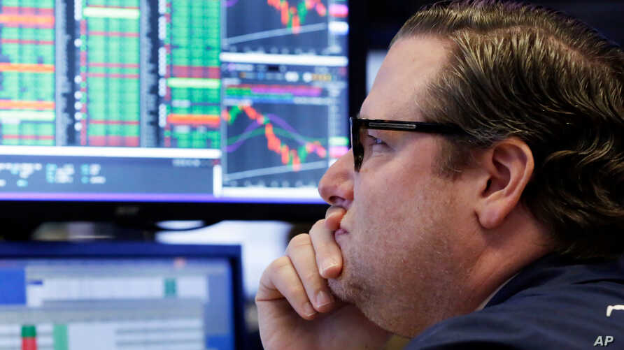 Financial Markets Wall StreetSpecialist Gregg Maloney works at his post on the floor of the New York Stock Exchange, in New York, April 23, 2018.