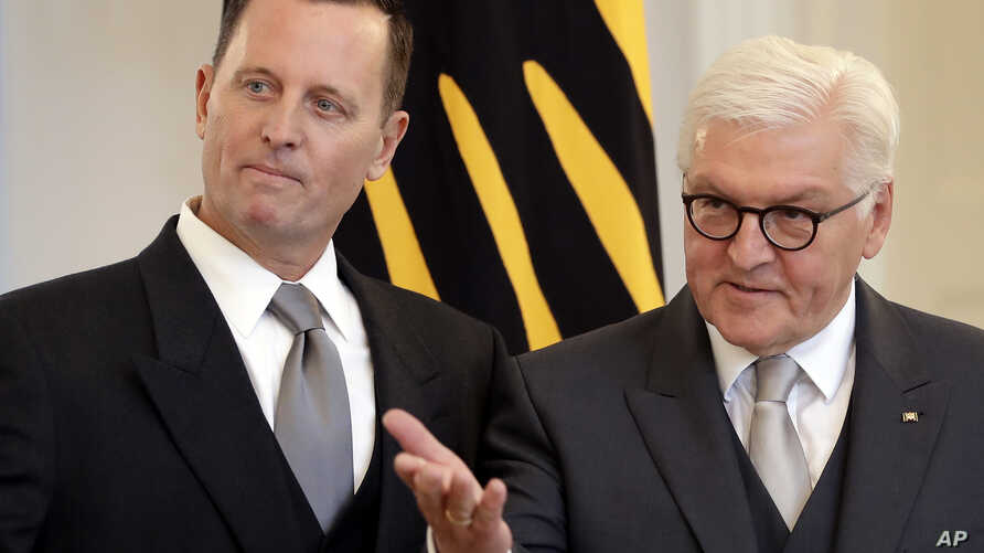 German President Frank-Walter Steinmeier, right, gestures during the accreditation of the U.S. Ambassador in Germany, Richard Allen Grenell, left, at the Belevue palace in Berlin, Germany, May 8, 2018.