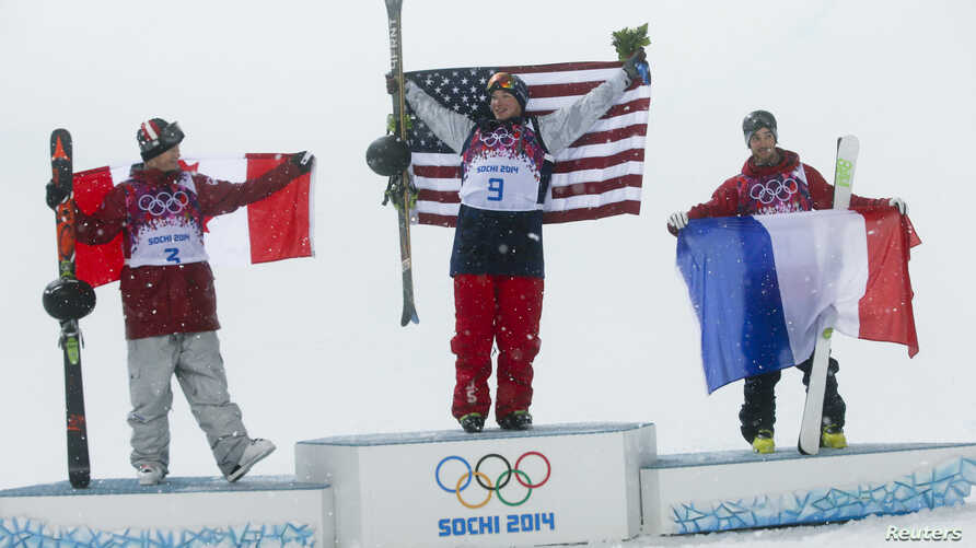 Canada's second placed Mike Riddle, first placed David Wise of the U.S. and France's third placed Kevin Rolland (L-R) celebrate on the podium after the men's freestyle skiing halfpipe finals at the 2014 Sochi Winter Olympic Games in Rosa Khutor, Russ