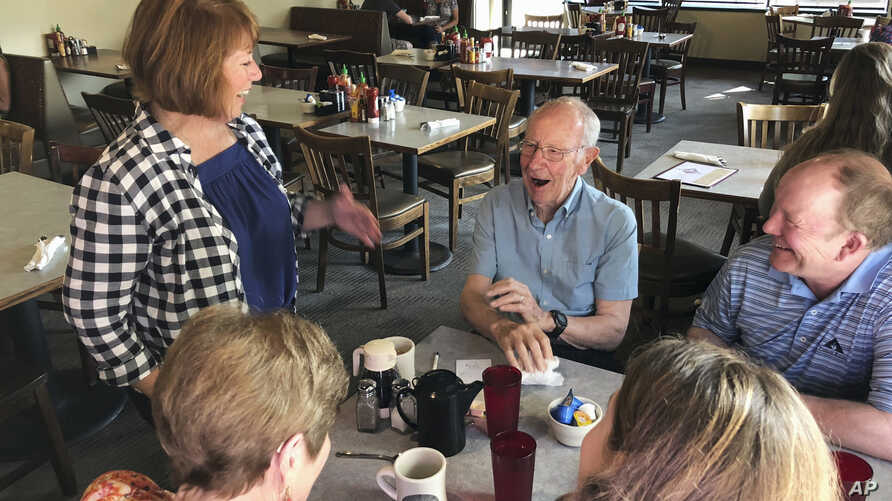 The Democratic-endorsed candidate for Minnesota governor, Rep. Erin Murphy, greets voters at the New Louisiana Cafe in St. Paul, Minn., Aug. 13, 2018, as she makes a final get-out-the-vote push ahead of the Tuesday primary.