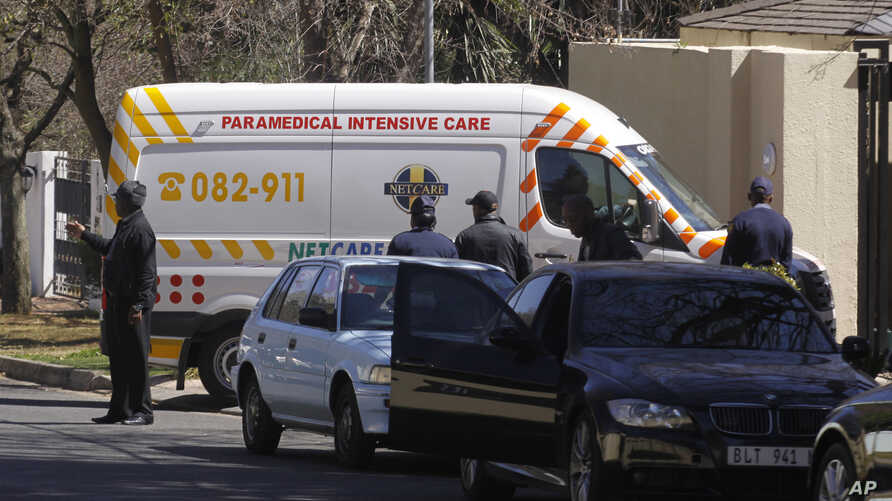 An ambulance transporting former South African president Nelson Mandela arrives at the home of the former statesman in Johannesburg, South Africa, Sept. 1, 2013.