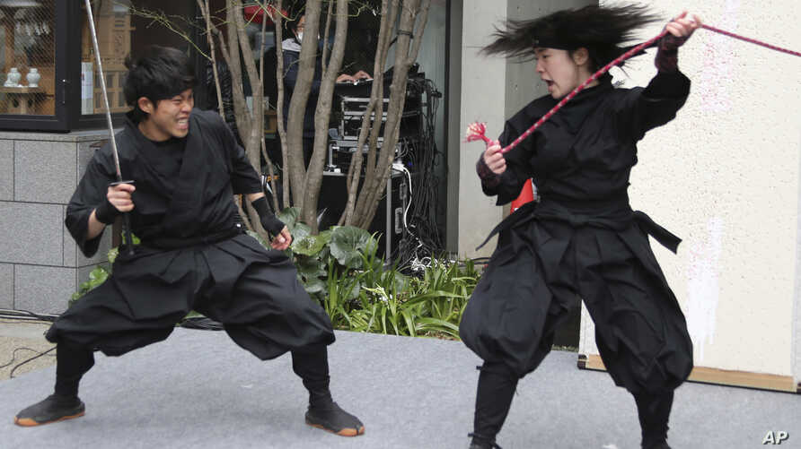 "Members of the Iga-Ninjya group ""Ashura""entertain visitors during the Nihonbashi cherry blossoms festival in Tokyo, March 26, 2016."