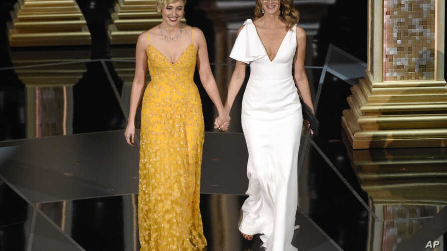Greta Gerwig, left, and Laura Dern walk on stage to present the award for best documentary feature at the Oscars on March 4, 2018, at the Dolby Theatre in Los Angeles.