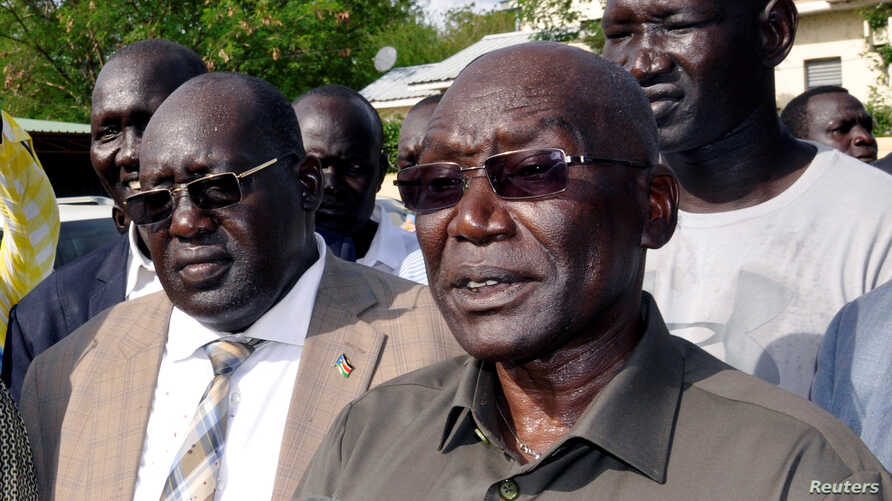 FILE - South Sudan's ousted army chief Paul Malong addresses the media after returning to the South Sudan's capital of Juba, May 13, 2017.