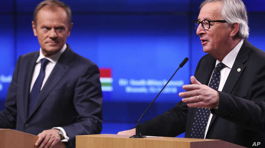 FILE - European Council President Donald Tusk, left, and European Commission President Jean-Claude Juncker participate in a news conference at the end of an EU-South Africa summit at the Europa building in Brussels on Thursday, Nov. 15, 2018.