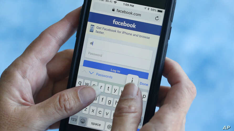 FILE - A Facebook start page is shown on a smartphone in Surfside, Florida. Aug. 21, 2018.