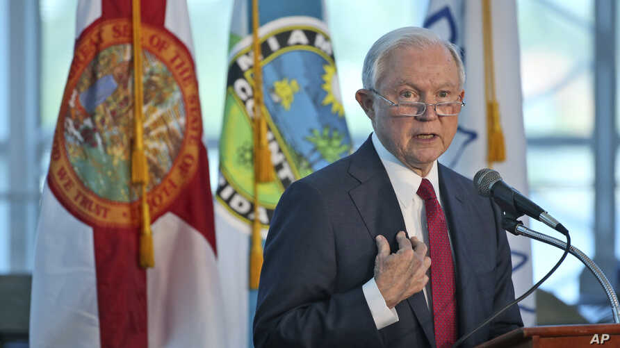 U.S. Attorney General Jeff Sessions gestures as he speaks during a news conference in Miami, Florida, Aug. 16, 2017.