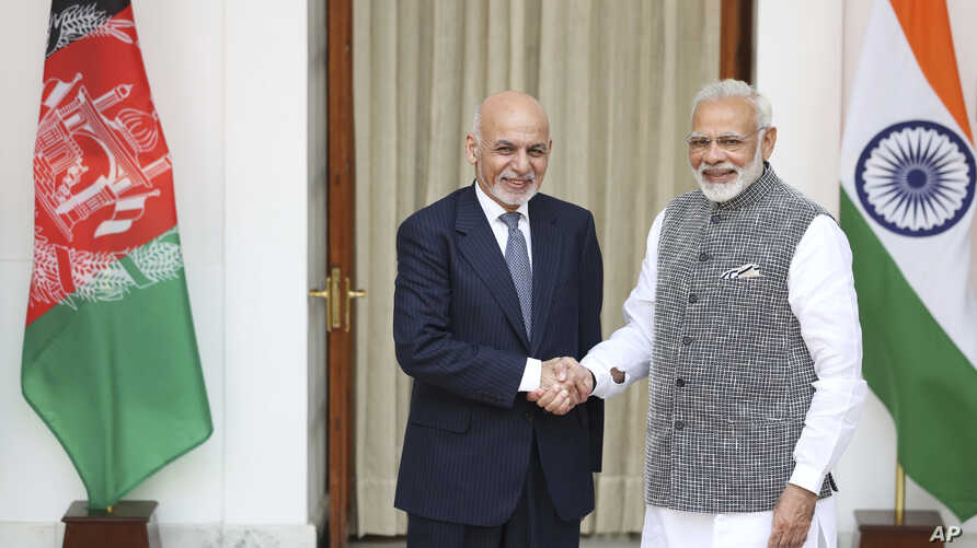 Afghan President Ashraf Ghani, left, and Indian Prime Minister Narendra Modi shake hands before the start of their official meeting in New Delhi, India, Oct. 24, 2017.