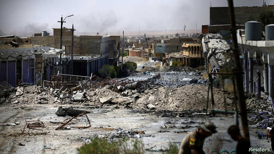 Destroyed buildings from clashes are seen, during the war between Iraqi army and Shi'ite Popular Mobilization Forces (PMF) against the Islamic State militants in Tal Afar, Iraq, Aug. 27, 2017.