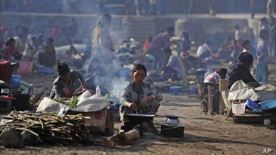 Burmese refugees from Bhamo city at a rescue camp in the Chinese southwestern border city of Ruili, Yunnan province, February 9, 2012.