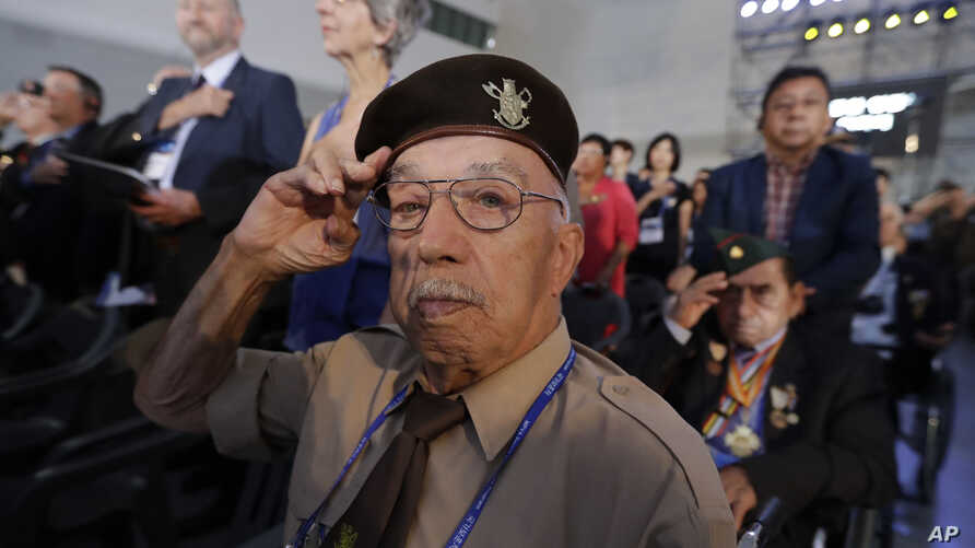 Belgium veteran of the Korean War Franciscus Ceuppens salutes during the commemorating ceremony for the U.N. Forces Participating Day in the Korean War in Seoul, South Korea, Friday, July 27, 2018.