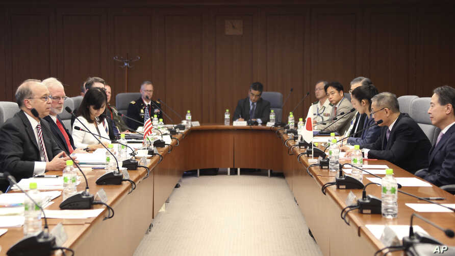 Assistant Secretary of State for East Asian and Pacific Affairs Daniel Russel, left, speaks as Assistant Secretary of Defense for Asian and Pacific Security Affairs David Shear, second from left, Director General of North American Affairs Bureau, Koj