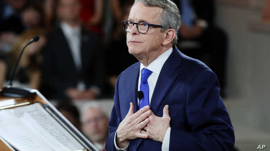 FILE -Ohio Governor Mike DeWine speaks during a public ceremony at the Ohio Statehouse, in Columbus, Ohio, Jan. 14, 2019.