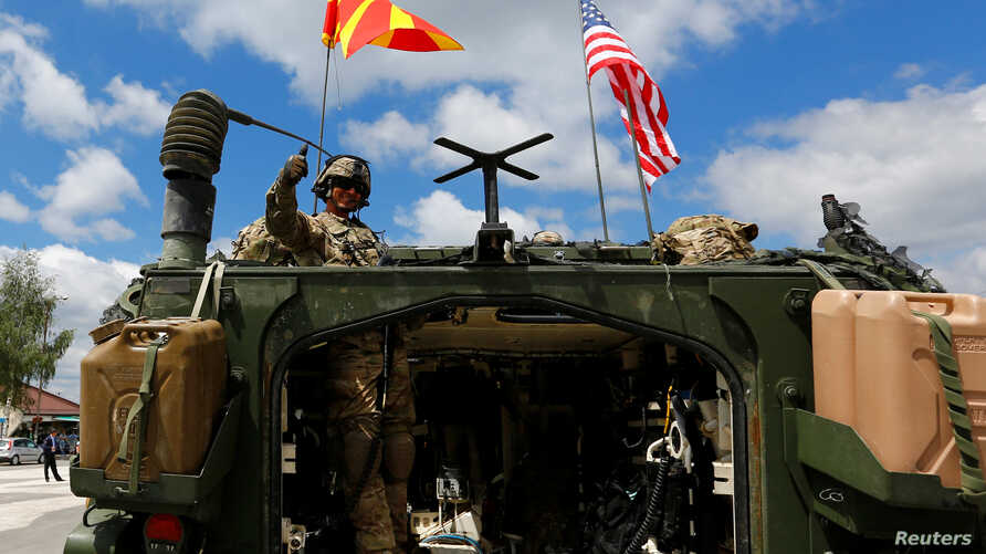 Members of US Army's 2nd Cavalry regiment enter Macedonia from Bulgaria at Devebair border crossing during a joint military exercise with Macedonia Army in Devebair, Macedonia, July 28, 2017.