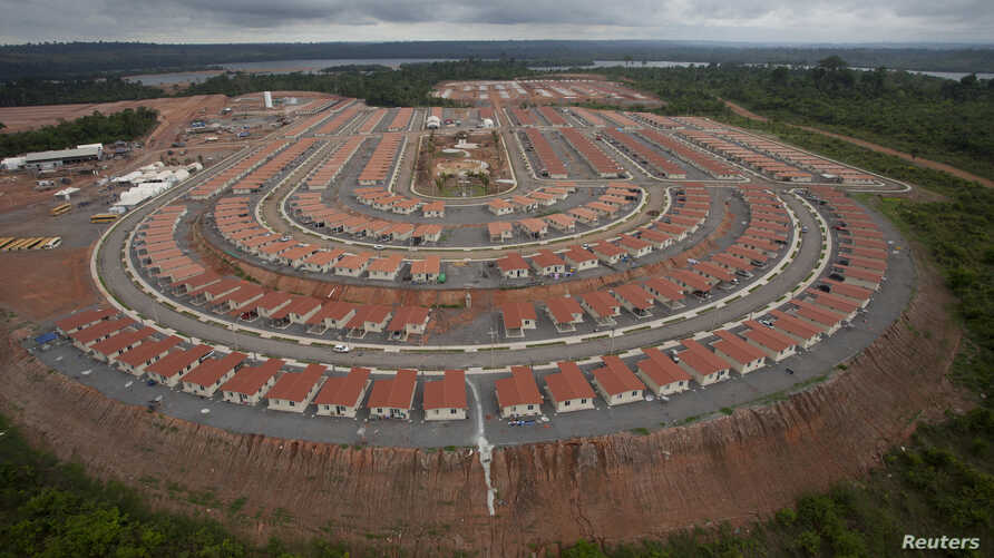 FILE - An overview of the houses being built for employees of the Belo Monte hydroelectric dam, planned to be the world's third largest, in Pimental, near Altamira in Para state.