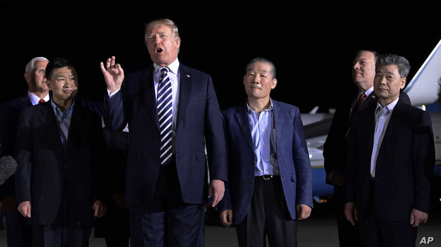 President Donald Trump speaks as he stands with Tony Kim, second left, Kim Dong Chul, center right, and Kim Hak Song, right, three Americans detained in North Korea for more than a year, after they arrived at Andrews Air Force Base in Md., May 10, 20...
