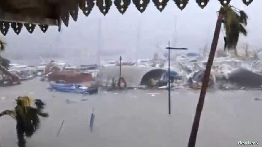 General view of half-submerged vehicles, boats and debris in the flooded harbour as Hurricane Irma  hits the French island territory of Saint Martin, Sept. 6, 2017, in this video grab made from footage taken from social media. (RCI GUADELOUPE/Handout