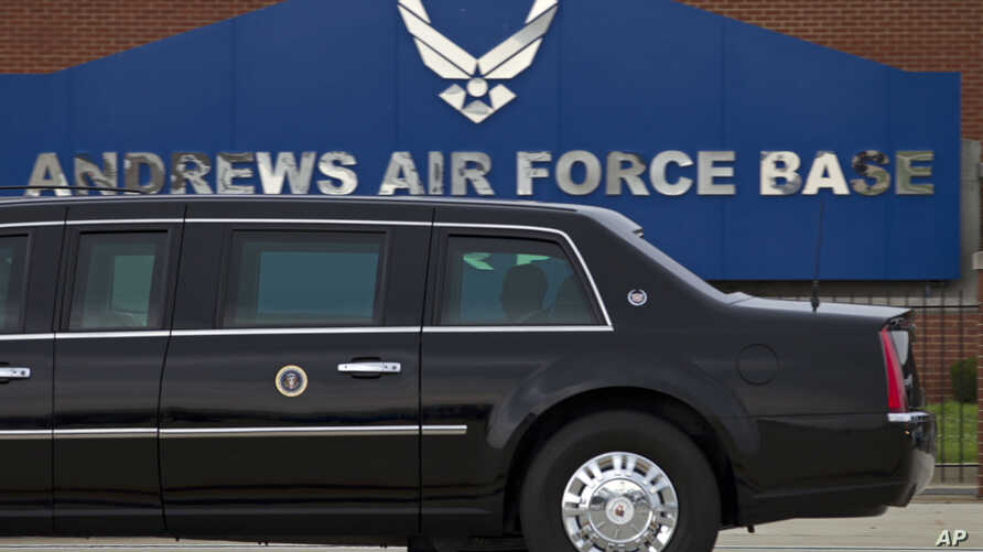 In this photo taken July 15, 2016, President Barack Obama rides in his limousine as he arrives at Joint Base Andrews, Maryland. Joint Base Andrews tweets that the base is on lockdown due to a report of an active shooter.